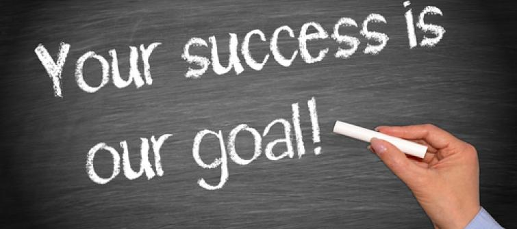 Blackboard with Your success is our goal! Written on it.