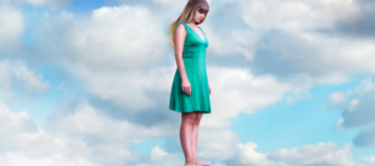 Woman standing on a cloud.