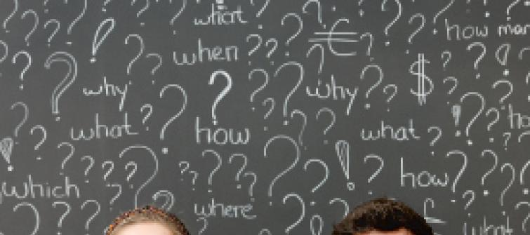 Chalkboard with question marks and who, what, where, when, why and how.