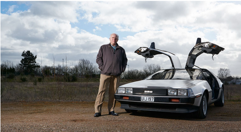 CEO standing outside of his Delorean.
