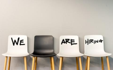 Four Chairs with Three Saying We Are Hiring