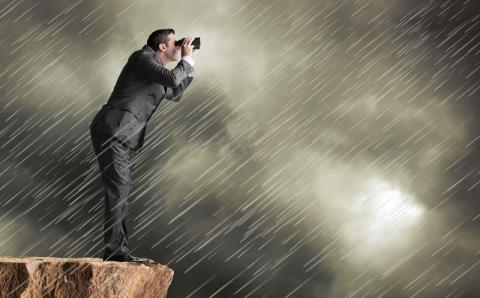 Professional in a rain storm taking pictures of clouds